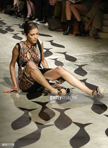 Model falls on the catwalk during a show for Italian fashion house Prada as part of the women's Spring/Summer 2009 ready-to-wear collections of the...