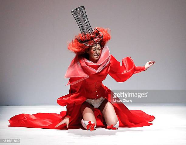 A model falls over on the runway at SECCRY Hu Sheguang Collection 2014 Show during MercedesBenz China Fashion Week Autumn/Winter 2014/2015 at the...