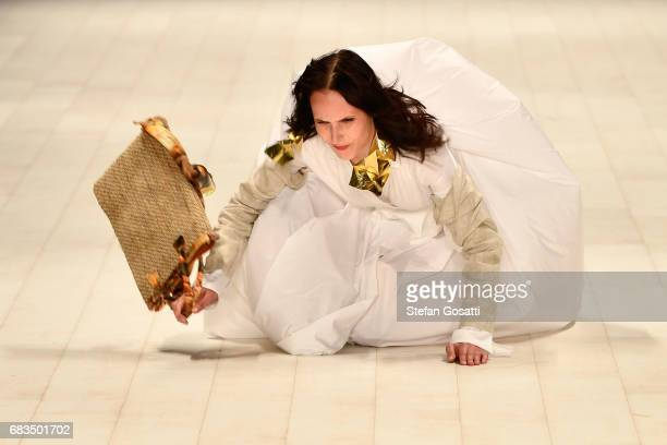Model falls over on the runway in a design by Victoria Bliss during the Project NextGen show at Mercedes-Benz Fashion Week Resort 18 Collections at...