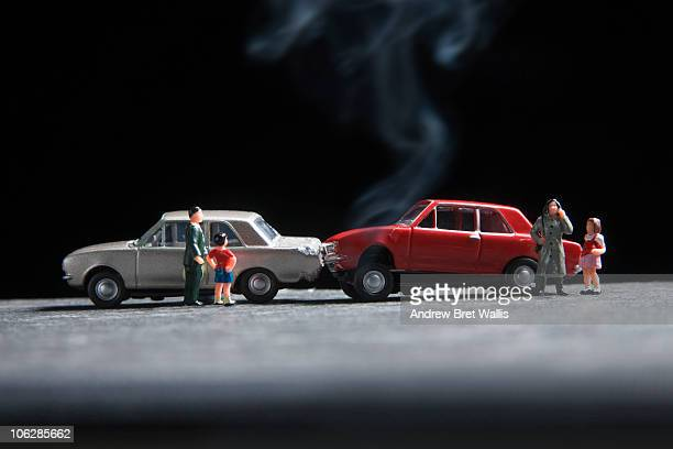 model family at the scene of a toy car crash