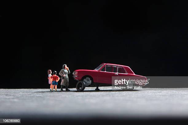 model family standing near toy car with a puncture - flat tire stock pictures, royalty-free photos & images
