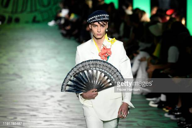 A model fan detail walks the runway at Dior Men's PreFall 2020 Runway Show on December 03 2019 in Miami Florida