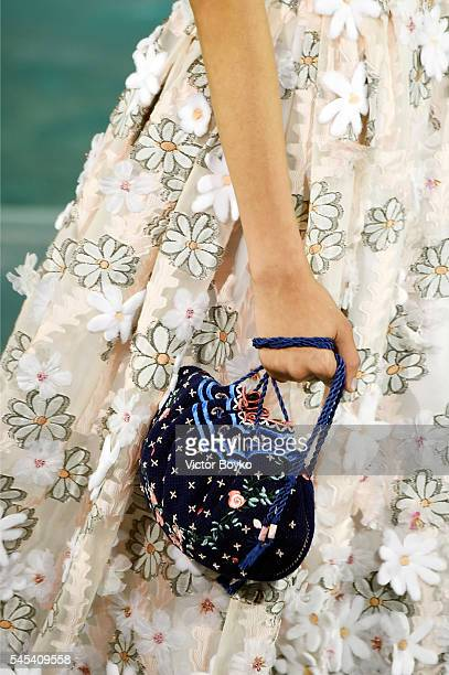 A model fashion detail walks the runway at Fendi Roma 90 Years Anniversary fashion show at Fontana di Trevi on July 7 2016 in Rome Italy