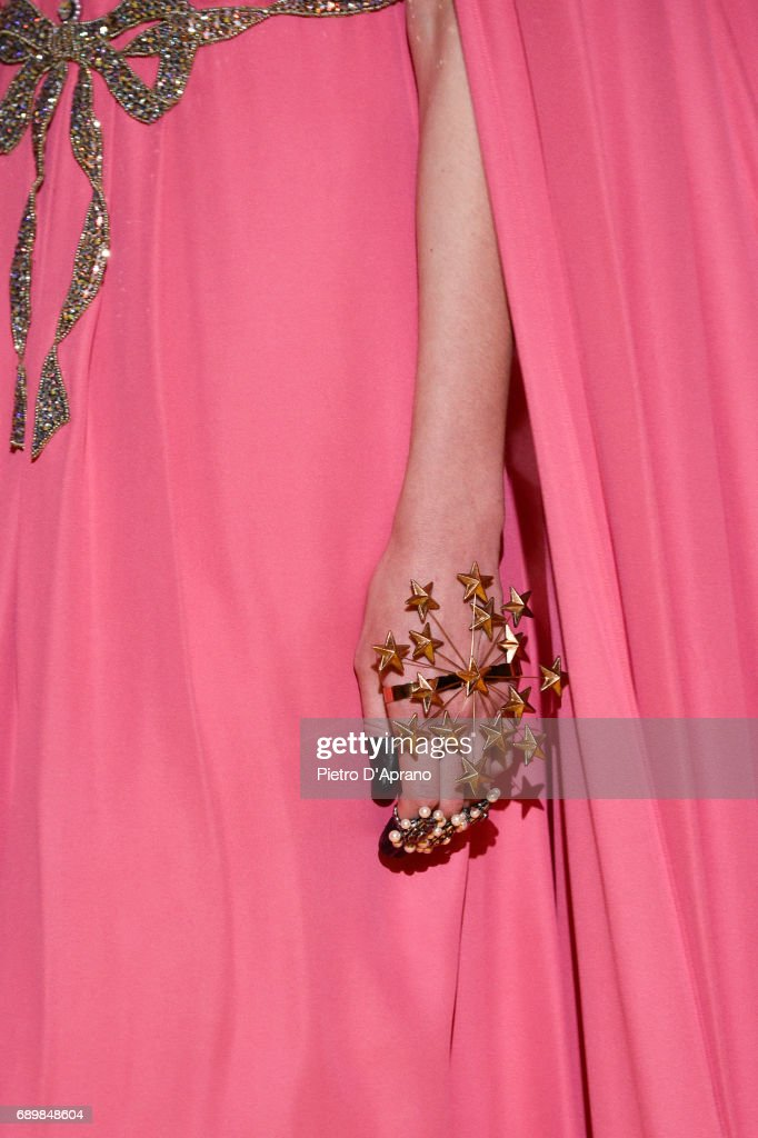 A model, fashion detail, walks the runway at the Gucci Cruise 2018 show at Palazzo Pitti on May 29, 2017 in Florence, Italy.