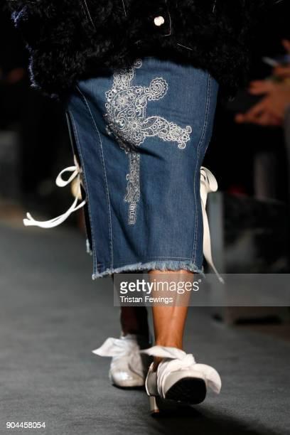 A model fashion detail walks the runway at the Miaoran show during Milan Men's Fashion Week Fall/Winter 2018/19 on January 13 2018 in Milan Italy