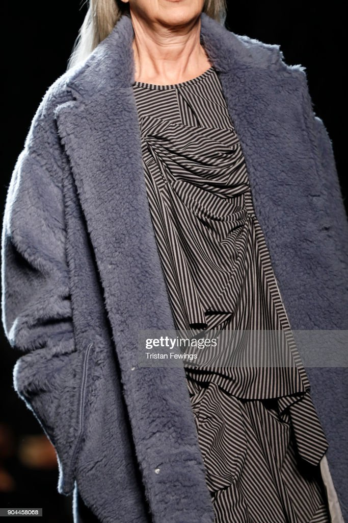 A model, fashion detail, walks the runway at the Miaoran show during Milan Men's Fashion Week Fall/Winter 2018/19 on January 13, 2018 in Milan, Italy.