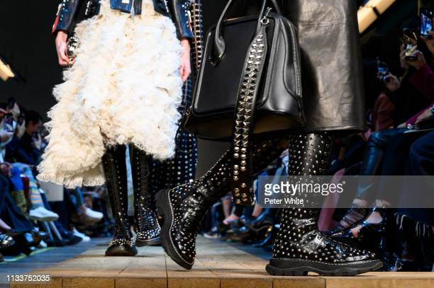 A model fashion detail walks the runway during the Alexander McQueen show as part of the Paris Fashion Week Womenswear Fall/Winter 2019/2020 on March...