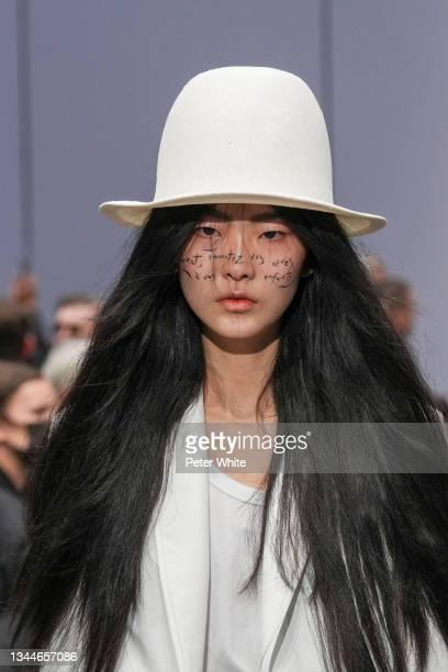 Model, fashion detail, walks the runway during the Ann Demeulemeester Womenswear Spring/Summer 2022 show as part of Paris Fashion Week on October 03,...