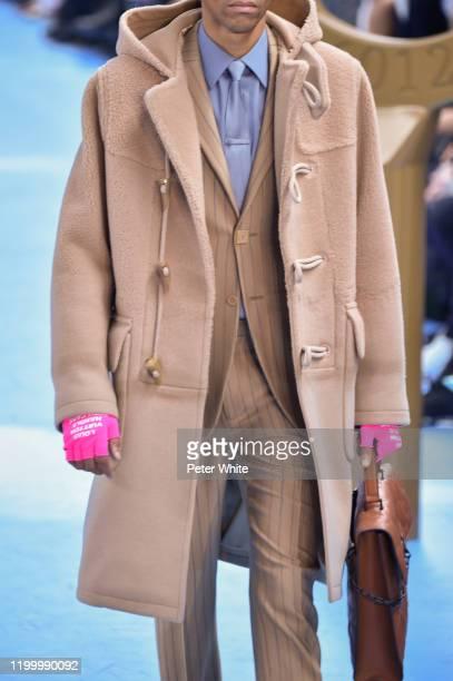 Model, fashion detail, walks the runway during the Louis Vuitton Menswear Fall/Winter 2020-2021 show as part of Paris Fashion Week on January 16,...