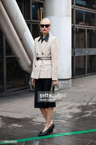 Model Fashion editor and stylist Yulia LobovaHarfouch wears Celine sunglasses Isabel Marant jacket Zara shirt Acne trousers Bottega Veneta shoes Kara...
