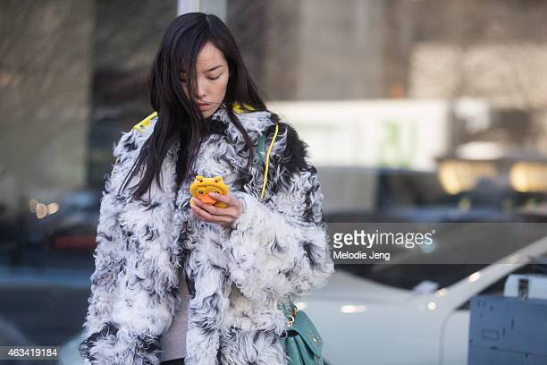 Model Fei Fei Sun wears a Chanel bag and Nike sneakers at Streets of Manhattan on February 13 2015 in New York City
