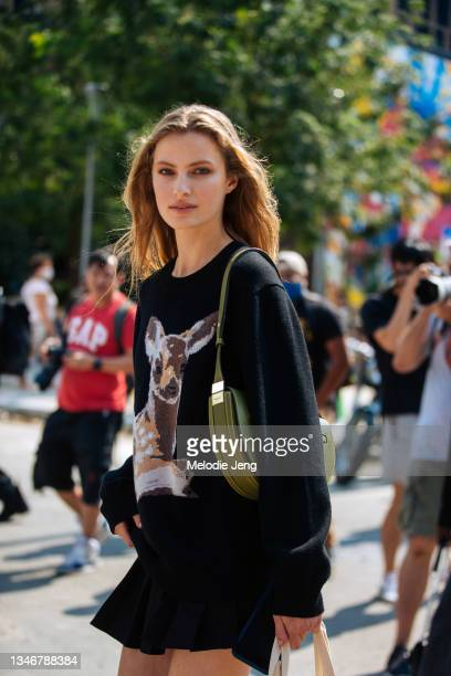 Model Felice Nova Noordhoff weasr a black Burberry Deer Intarsia Wool Sweater and carries a green purse after the Khaite show on September 12, 2021...
