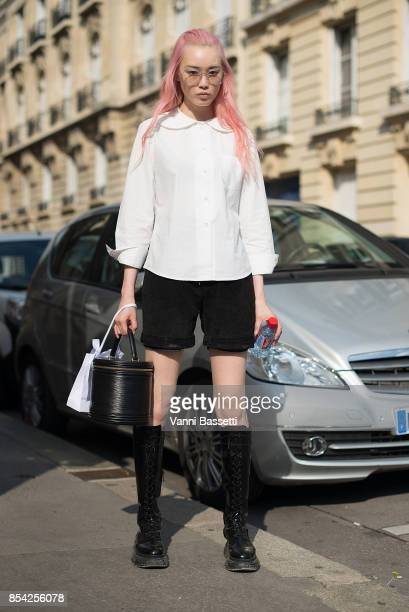 Model Fernanda Ly poses after the Dior show at the Musee Rodin during Paris Fashion Week Womenswear SS18 on September 26 2017 in Paris France