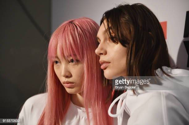 Model Fernanda Ly poses backstage before the LiNing Fall/Winter 2018 Collection Fashion Show during 2018 New York Fashion Week at Skylight Modern on...
