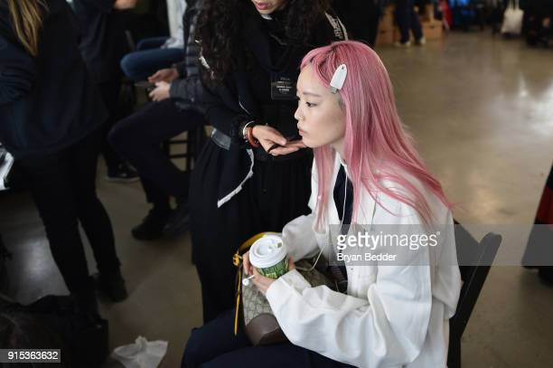 Model Fernanda Ly prepares backstage before the LiNing Fall/Winter 2018 Collection Fashion Show during 2018 New York Fashion Week at Skylight Modern...