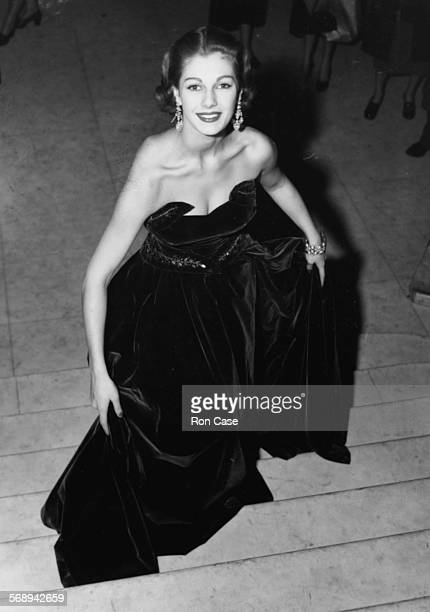 Model Fiona Walters wearing a green velvet bodice and skirt as she attends a fashion show at Park Lane House Park Lane London November 25th 1952