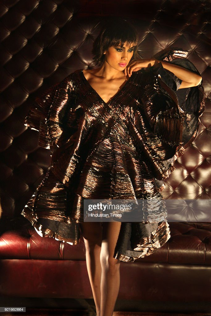 A model flaunts a creation by fashion designer Rohit Bal during preview of his new collection for Wills Fashion Week, in New Delhi.