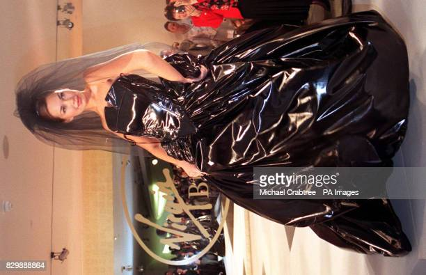 A model flaunts a stunning black PVC weding gown on the catwalk at the launch today of Richard Branson's latest venture the opening of his 'Virgin...