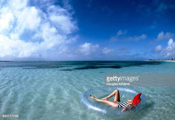 Model floating in the Bahamas