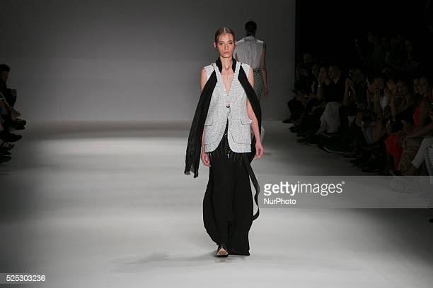 Model for designer fashion show Apartamento 03 the fourth day of Sao Paulo Fashion Week Summer 2016 in C��ndido Portinari park in west region of S��o...