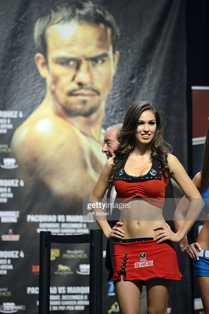 A model for sponsor Tecate beer appears during the offical weigh-in for boxers Manny Pacquiao and Juan Manuel Marquez for their welterweight bout at the MGM Grand Garden Arena on December 7, 2012 in Las Vegas, Nevada. Pacquiao and Marquez will fight each other for the fourth time on Dec. 8 in Las Vegas.