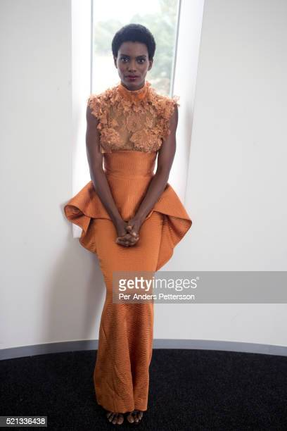 A model for the South African designer David Tlale waits backstage before showing his latest collection at Mercedes Benz Africa fashion week Africa...
