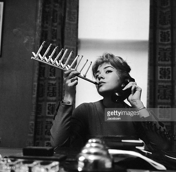 Model Frances Richards smokes a pack of cigarettes all on one cigarette holder