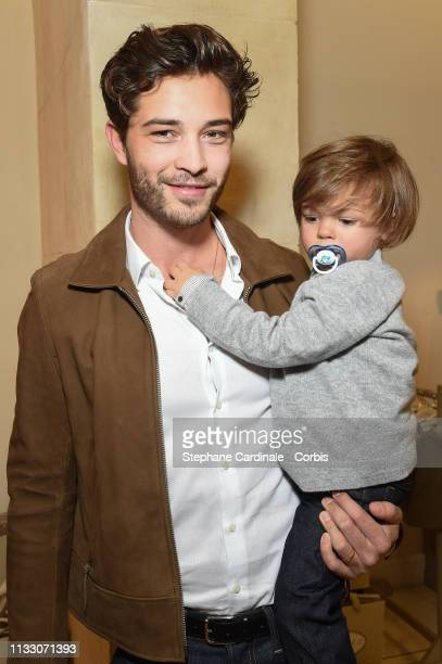 Model Francisco Lachowski with his son Laslo Lachowski attend the Bonpoint Cocktail for the book Lachowski Family by Ricardo Gomes as part of the...