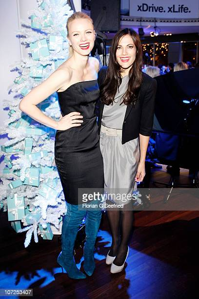 Model Franziska Knuppe and actress Bettina Zimmermann attend the 'Launch of the BMW Art Advent Calender 2010' at the BMW branch on December 2 2010 in...