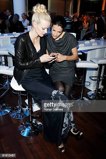 Model Franziska Knuppe and actress Bettina Zimmermann attend the presentation of the new 'BMW 5er Gran Turismo' and 'BMW X1' at a BMW branch on...