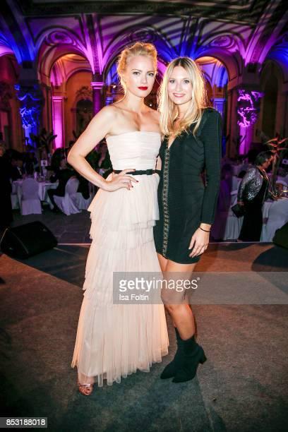 Model Franziska Knuppe and Carolin Niemczyk of the duo Glasperlenspiel during the Minx Fashion Night in favour of 'Sauti Kuu' of Auma Obama at...