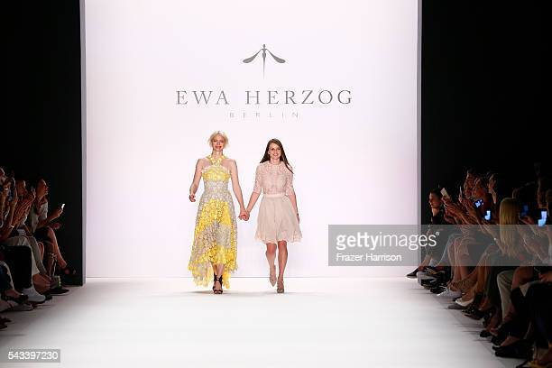 Model Franziska Knuppe and designer Ewa Herzog acknowledge the applause of the audience at the Ewa Herzog show during the MercedesBenz Fashion Week...
