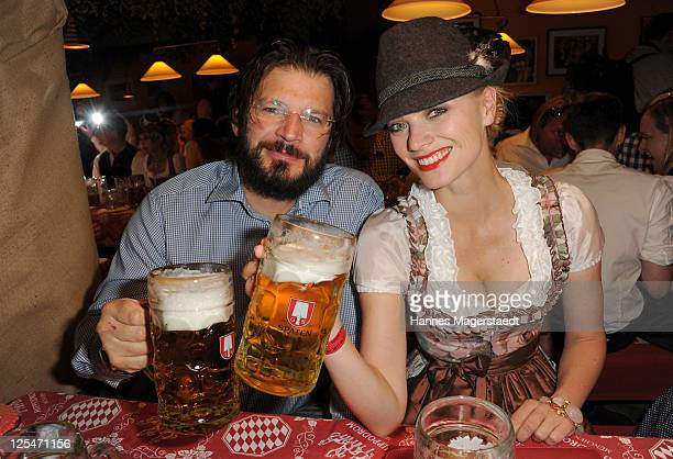 Model Franziska Knuppe and her husband Christian Moestl attend the Oktoberfest beer festival at Hippodrom beer tent on September 17, 2011 in Munich,...