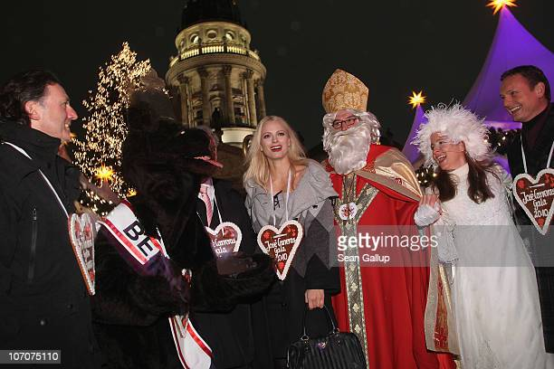 Model Franziska Knuppe and television host Axel Bulthaupt attend the official opening of the Christmas Market at Gendarmenmarkt on November 22 2010...