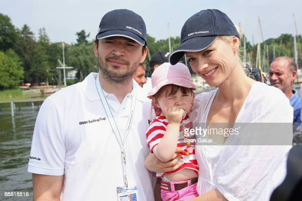 Model Franziska Knuppe, her husband Christian Moestl and their daughter Mathilda attend the BMW Sailing Cup at Wannsee Lake on July 4, 2009 in...