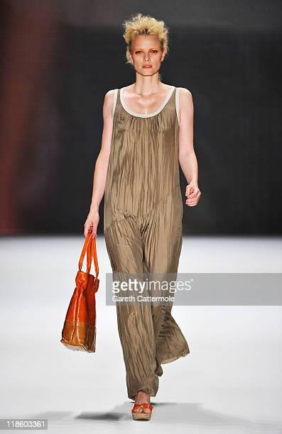 Model Franziska Knuppe walks the runway at the Minx by Eva Lutz Show during MercedesBenz Fashion Week Berlin Spring/Summer 2012 at the Brandenburg...