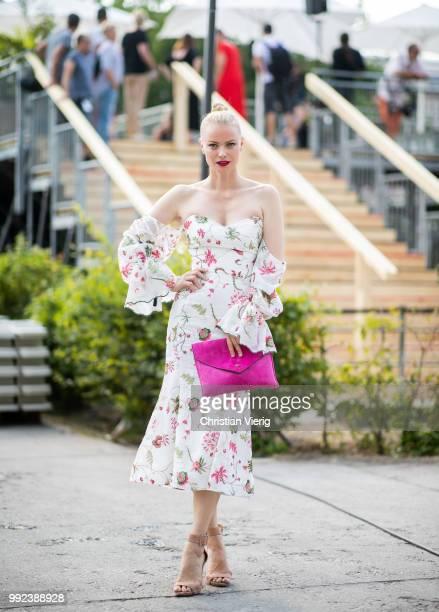 Model Franziska Knuppe wearing off shoulder dress Lana Mueller pink clutch is seen outside Lana Mueller during the Berlin Fashion Week July 2018 on...