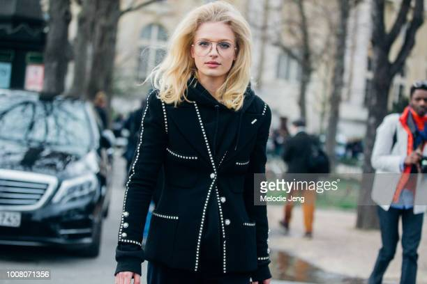 Model Frederikke Sofie in glasses spider eyelashes and a black blazer after the Chanel show at Grand Palais during Paris Fashion Week Fall/Winter...