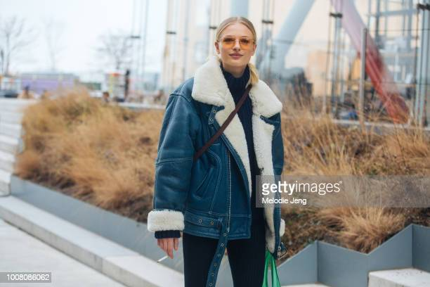 Model Frederikke Sofie in orange sunglasses and a blue shearling leather bomber jacket after Tory Burch on Day 6 of New York Fashion Week Fall/Winter...