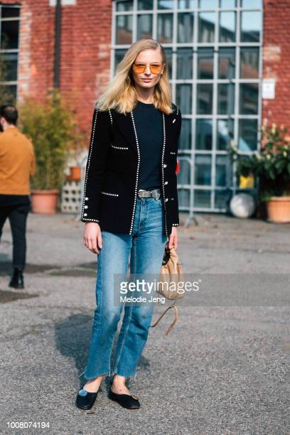 Model Frederikke Sofie wears yellow sunglasses a black jacket blue jeans and black flats after the Missoni show during Milan Fashion Week Fall/Winter...