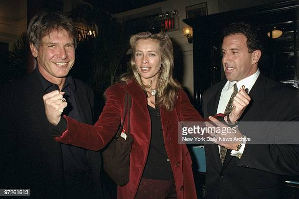 Model Frederique van der Wal flexes her muscles for Harrison Ford and Jake Steinfeld at party in Le Colonial restaurant to launch the magazine Body...