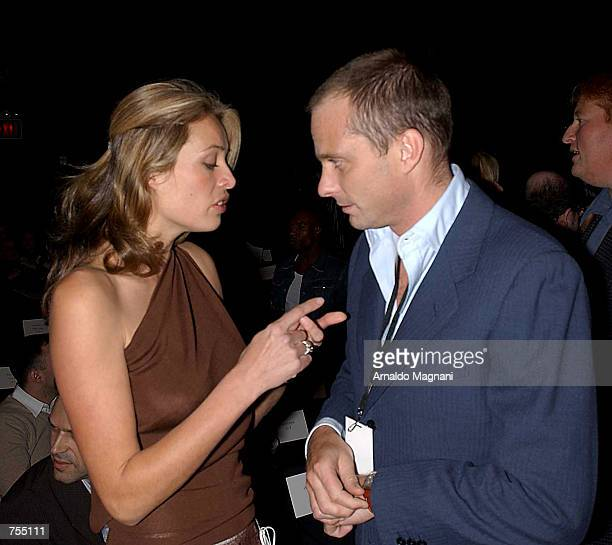 Model Frederique Van Der Wal talks with Giuseppe Cipriani at the Luca Luca Fashion Show February 12 2002 in New York City