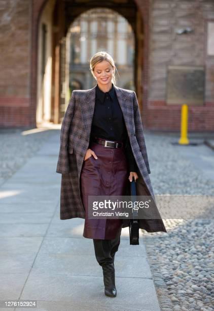 Model Frida Aasen is seen wearing checkered coat, bordeaux skirt outside Alberta Ferretti during the Milan Women's Fashion Week on September 23, 2020...