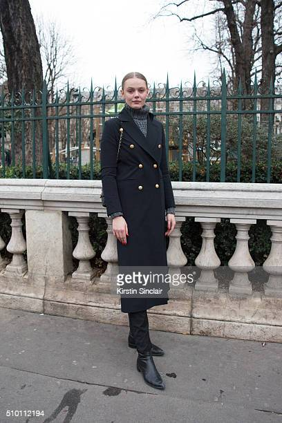 Model Frida Gustavsson wears a Hunky Dory coat Blk Denim jeans Saint Laurent boots and a Chanel bag on day 4 of Paris Haute Couture Fashion Week...