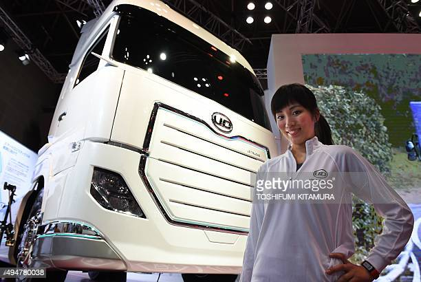 A model from Volvo group Japanese truck maker UD shows off the company's Quon Vision at the Tokyo Motor Show in Tokyo on October 29 2015 The biennial...