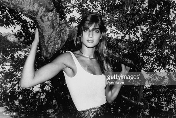 Model Gabrielle Reece at 6'3 posing by tree in park near school where she plays on volleyball team