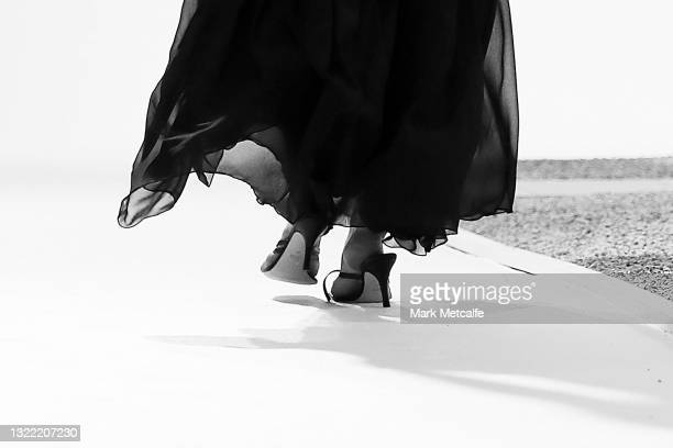 Model Gemma Ward walks the runway in a shoe with a broken strap during the Christopher Esber show during Afterpay Australian Fashion Week 2021 Resort...