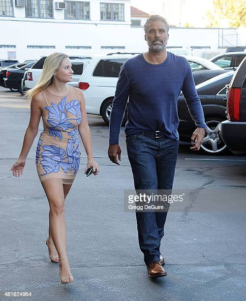 Model Genevieve Morton and former NBA player RIck Fox arrive at the premiere of 'Sharknado 3 Oh Hell No' at iPic Theaters on July 22 2015 in Los...