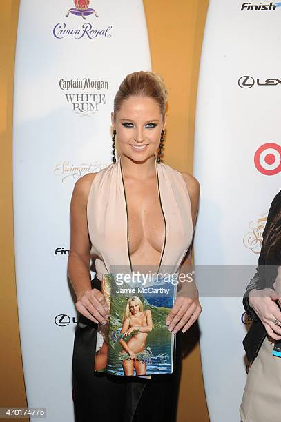 Model Genevieve Morton attends the Sports Illustrated Swimsuit 50 Years of Swim in NYC Celebration at the Sports Illustrated Swimsuit Beach House on...