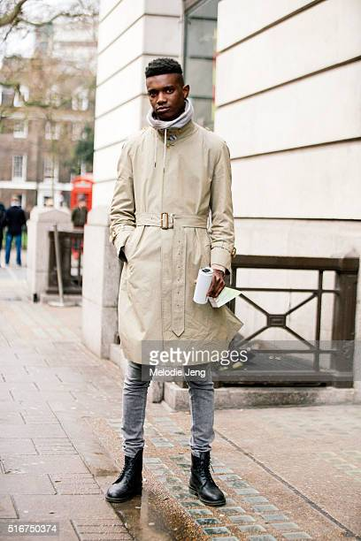 Model George Koh wears a tan belted trench a sweater with a high collar skinny gray jeans and black boots after the Agi Sam show at Victoria House...
